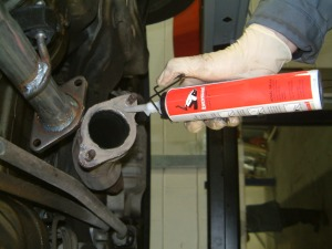 mechanic-applying-exhaust-paste