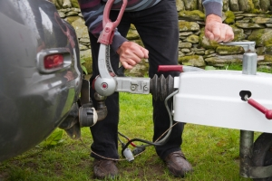 stock-image-of-attaching-caravan-to-vehicle